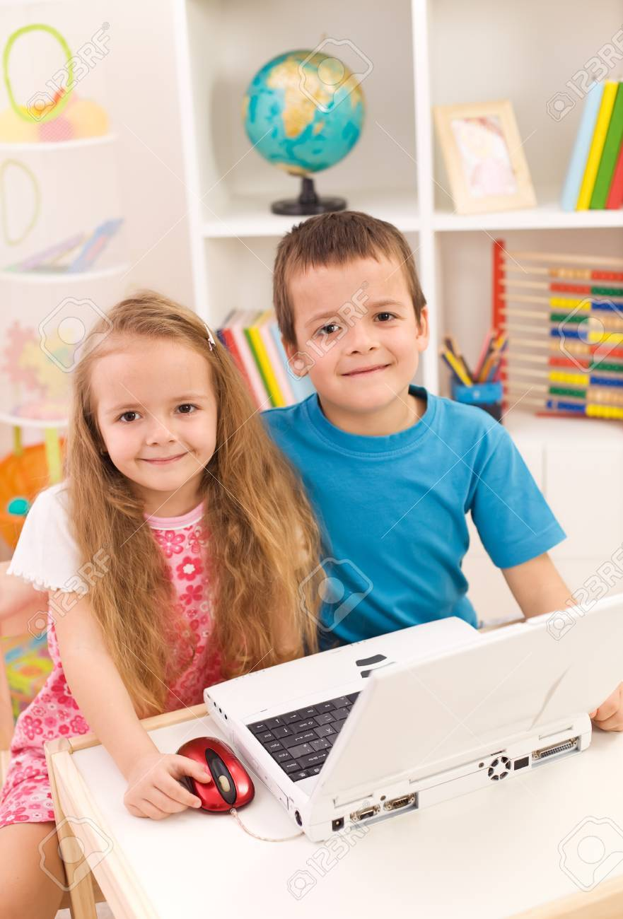 Little boy and girl with laptop computer in their room smiling to the camera Stock Photo - 9182936