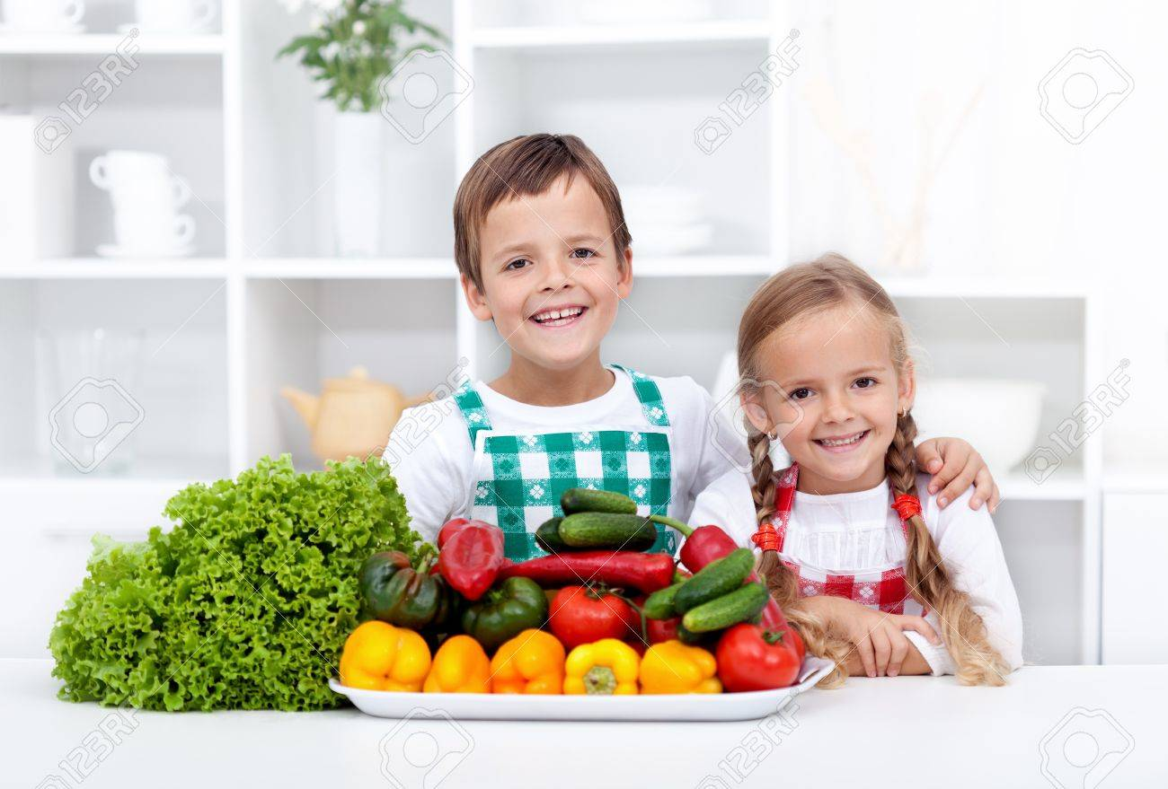 Happy Healthy Kids With Vegetables In The Kitchen Ready To