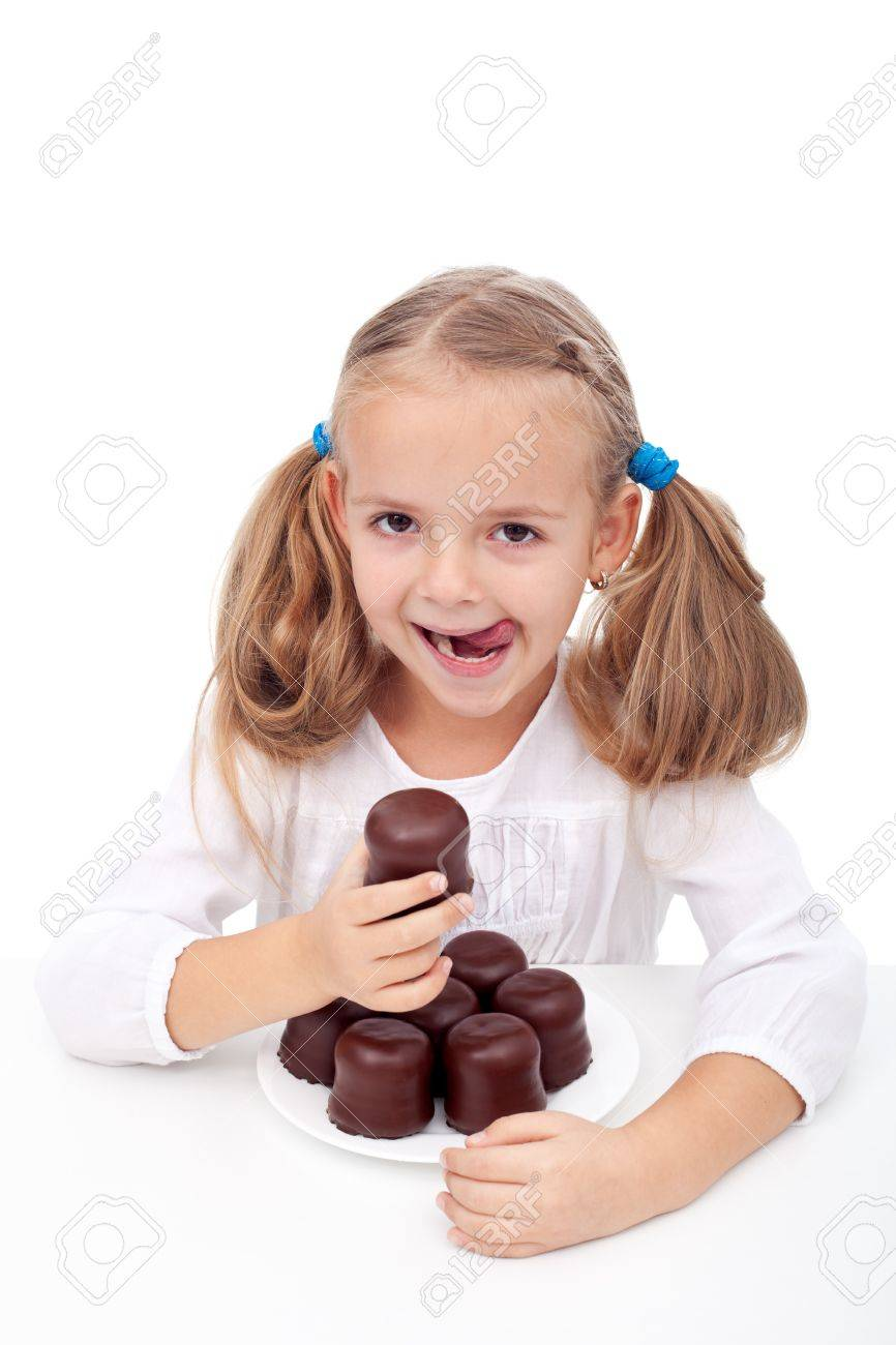 Little girl with a sweet tooth eating large chocolate coated cookies Stock Photo - 11411249