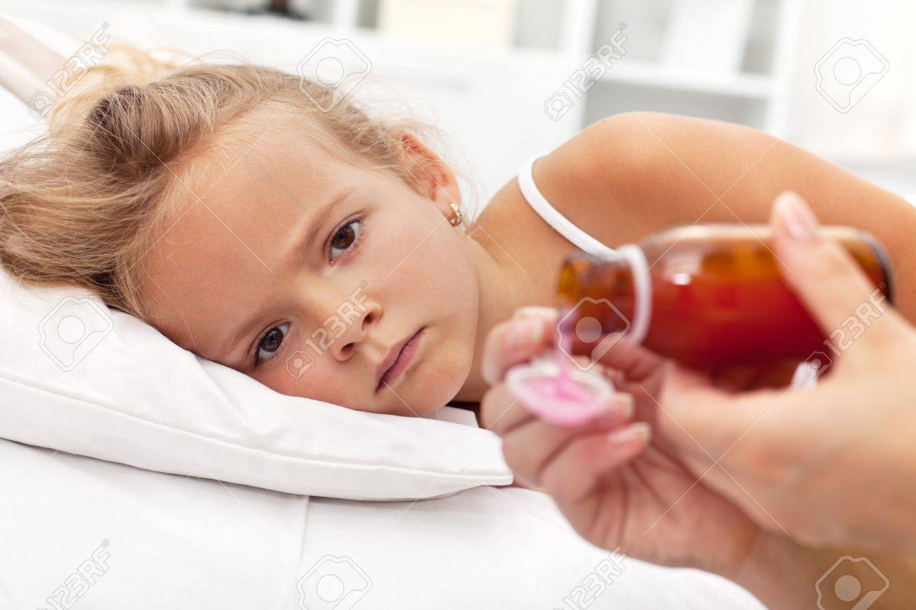Sick little girl with flu awaiting medication- focus on the eyes Stock Photo - 11411278