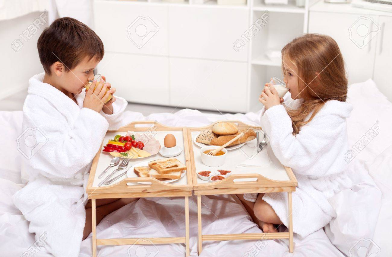 Breakfast In Bed Kids Having A Meal In The Morning Stock Photo Picture And Royalty Free Image Image 11411310