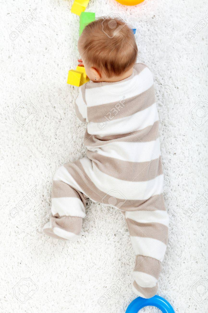 Baby crawling on the floor - top view Stock Photo - 12078507