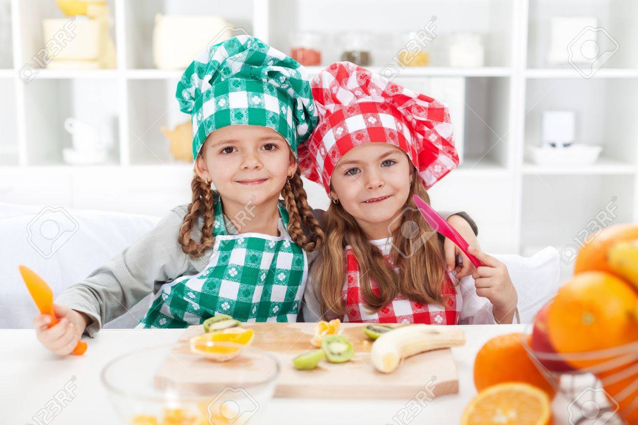 Little Chef Girls Slicing Fruits In The Kitchen   Healthy Eating Stock  Photo   12477455