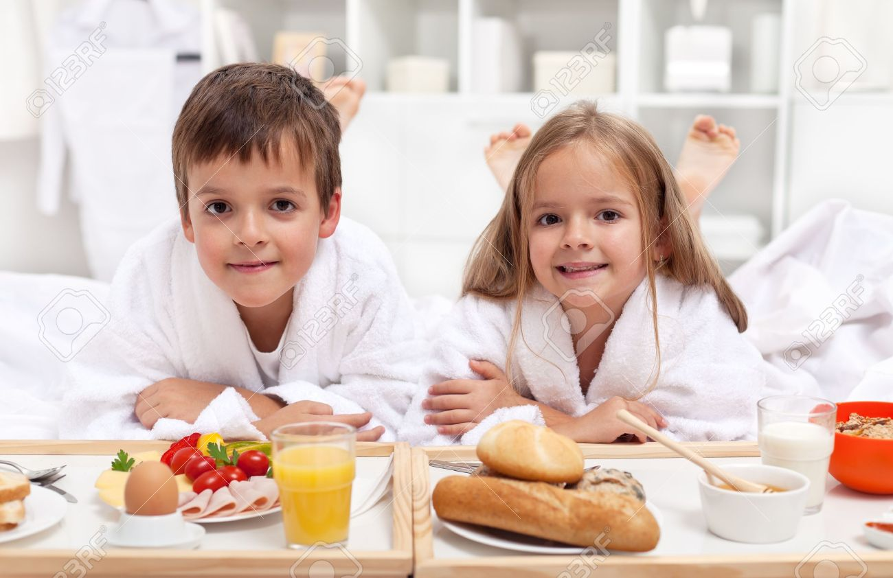 Kids Having A Healthy And Various Breakfast In Bed Stock Photo Picture And Royalty Free Image Image 12477530