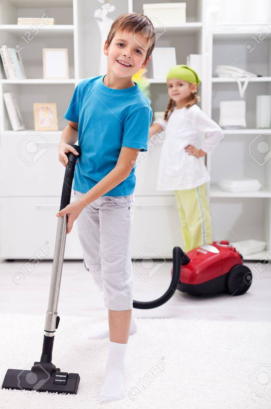 kids cleaning the room boy using a vacuum cleaner stock po 12477536