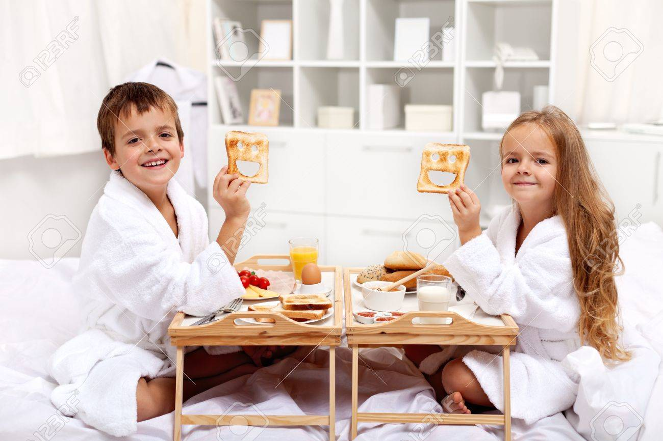 Breakfast In Bed With Happy Kids Having A Healthy And Varied Stock Photo Picture And Royalty Free Image Image 12478080