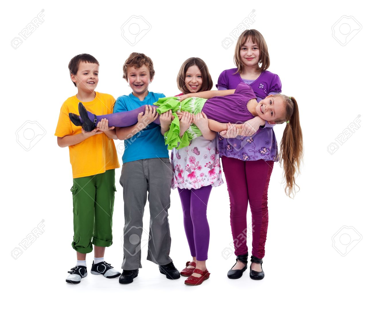 Kids having fun lifting their friend in their arms - isolated Stock Photo - 12477734
