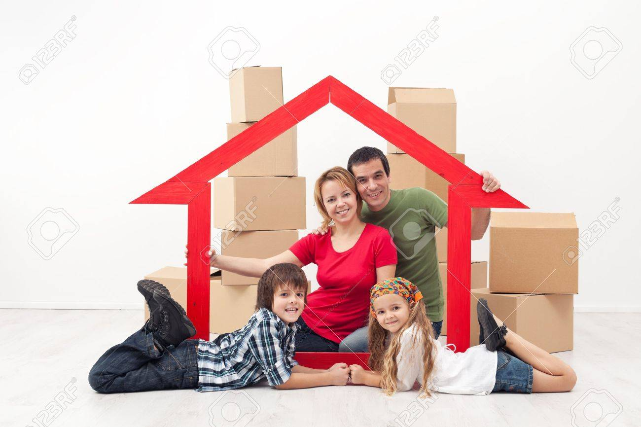 Happy family in a new home concept - sitting with cardboard boxes Stock Photo - 17184759