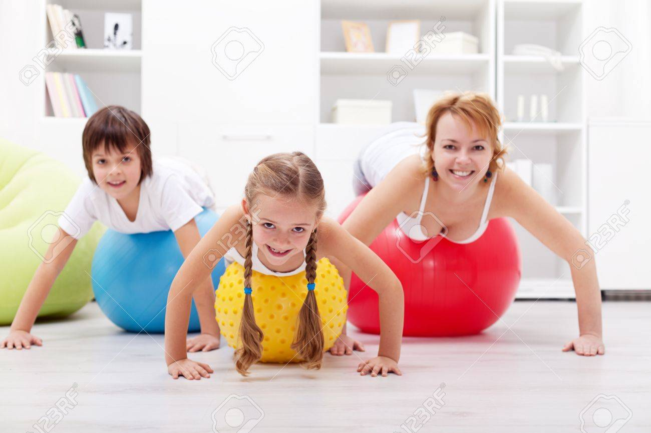 gymnastic kids Happy people exercising - woman and kids with large gymnastic balls Stock Photo - 17921450