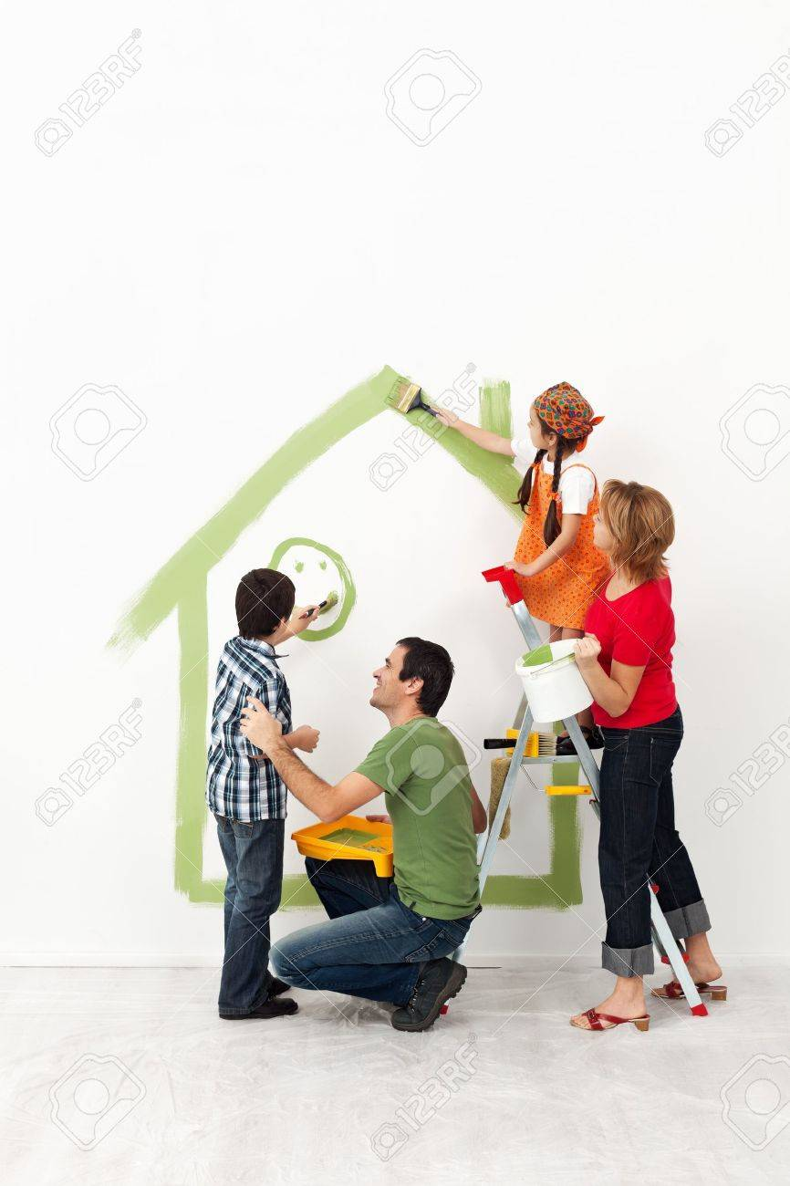 Happy family painting their home together with the kids - 18162511
