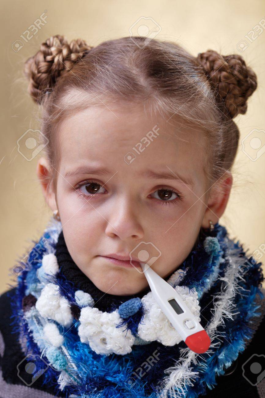Little girl with red eyes having the flu - checking temperature Stock Photo - 18494343