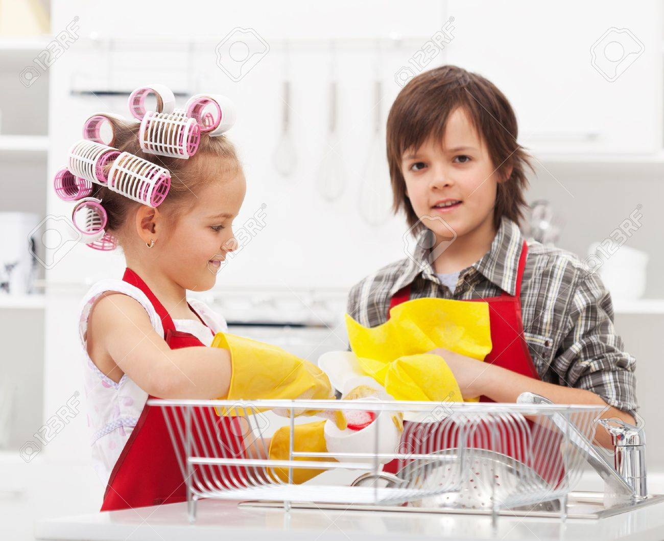 Kids doing the dishes together in the kitchen - closeup on sink area - 19337281