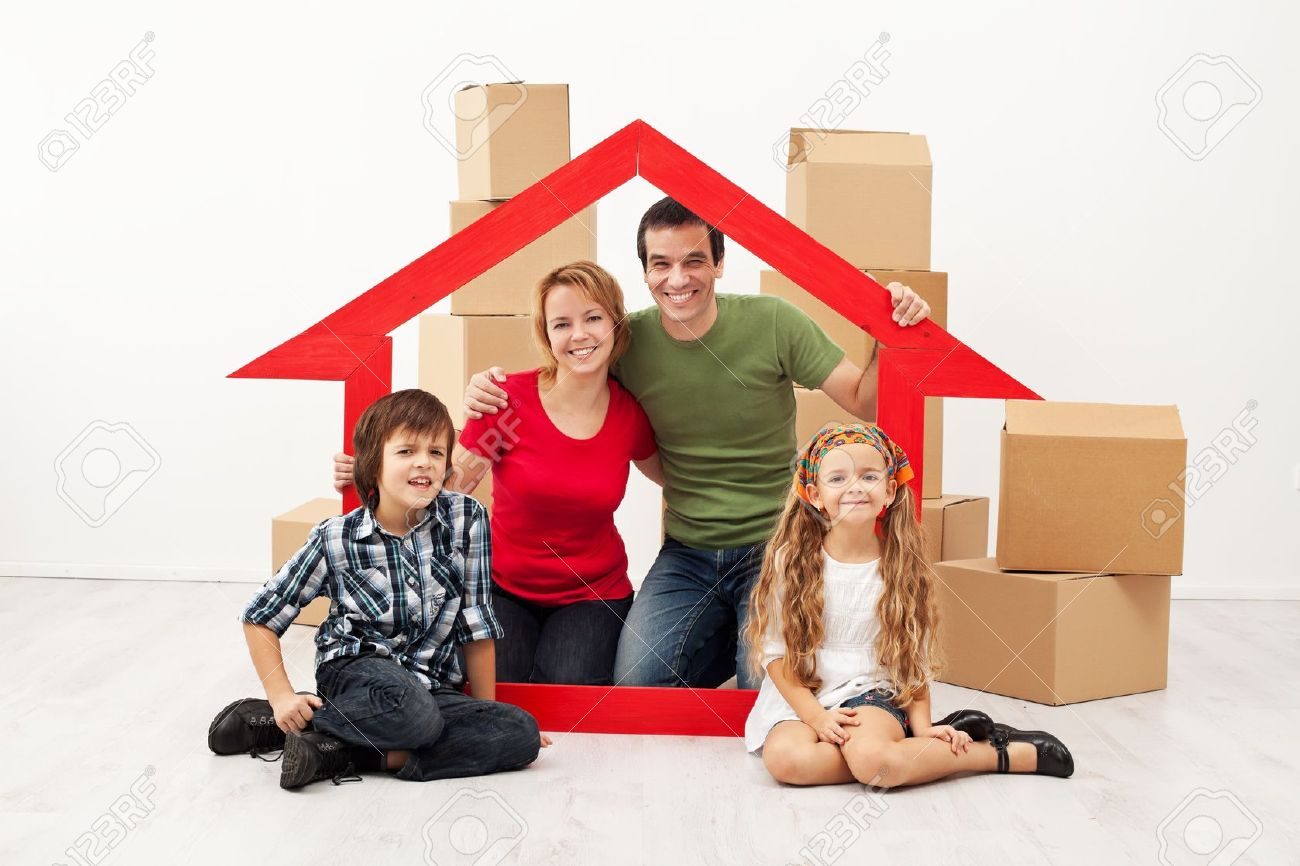 Happy family with kids moving into a new home - sitting with cardboard boxes - 19505419