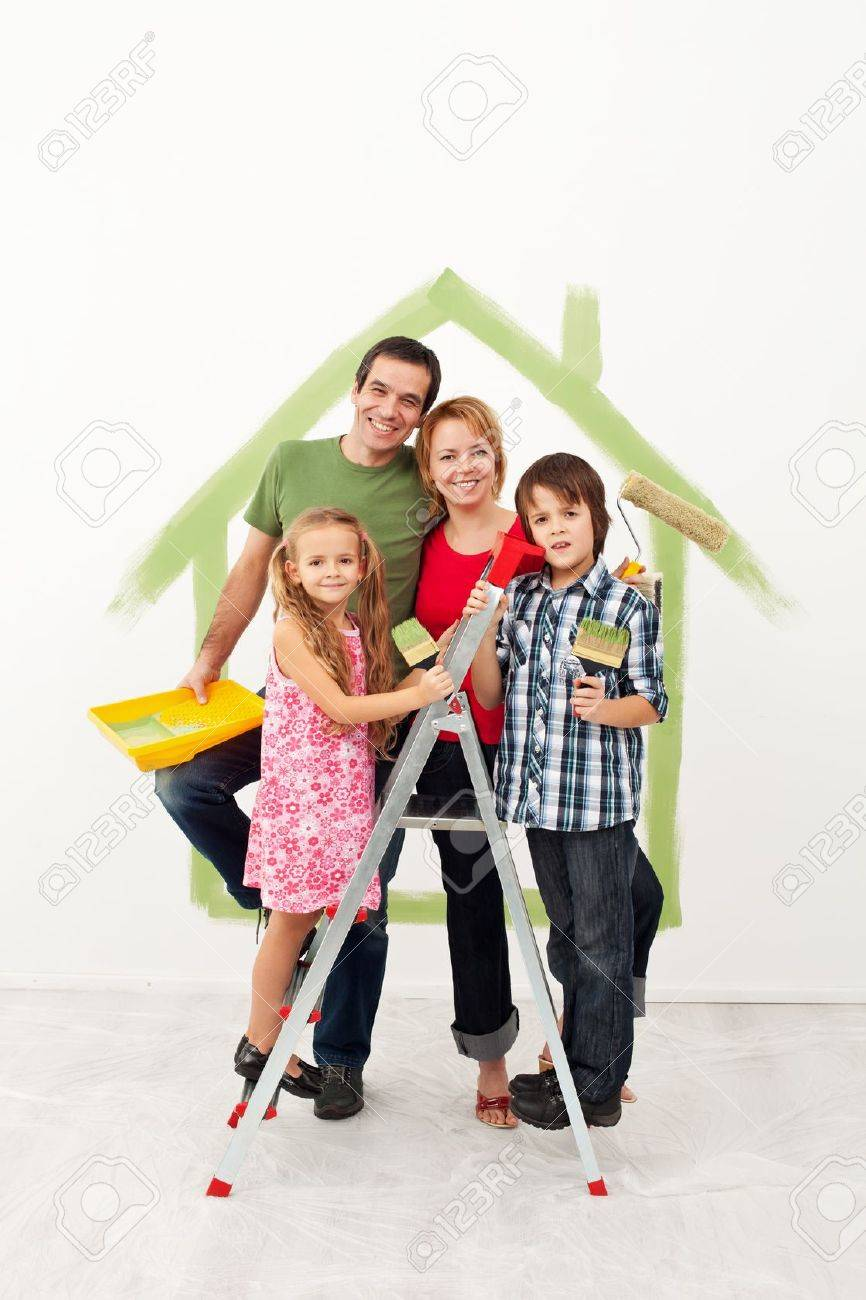 Happy family with kids redecorating their home together - 19505415