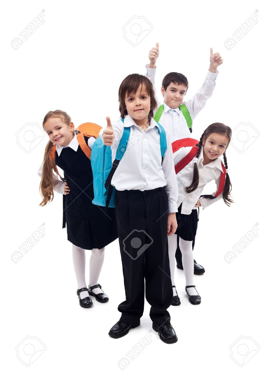 Group of happy kids with backpacks returning to school after summer vacation - 21140130