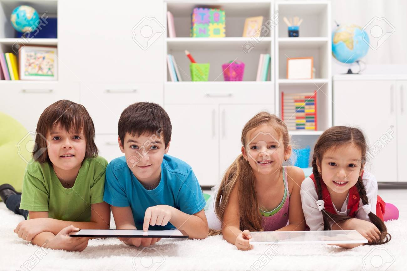 Happy kids using tablet computers - 21450638