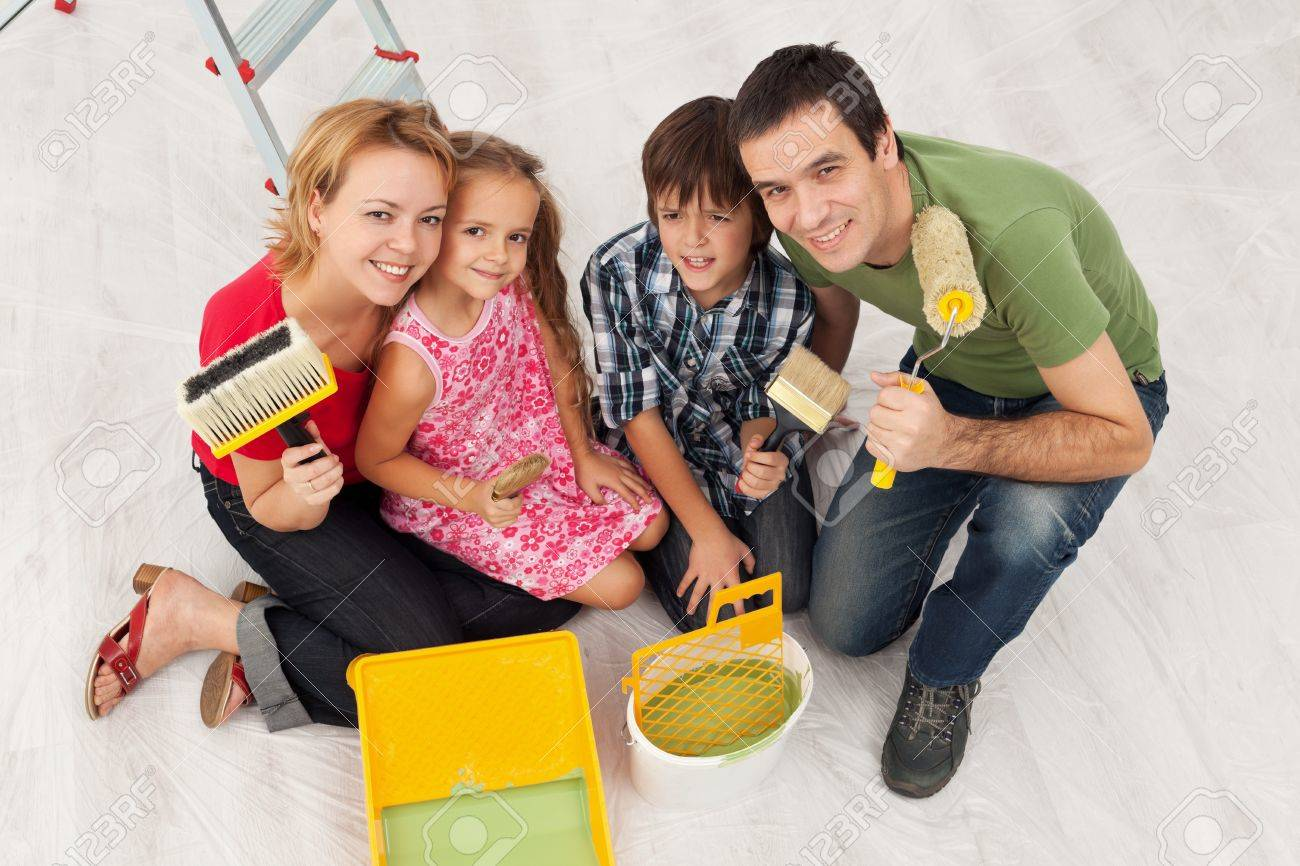 Happy family redecorating their home - sitting together with painting utensils Stock Photo - 21966728