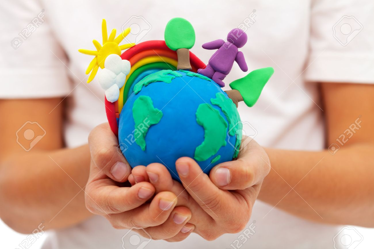 Life on earth - environment and ecology concept with clay earth globe in child hands - 24081240