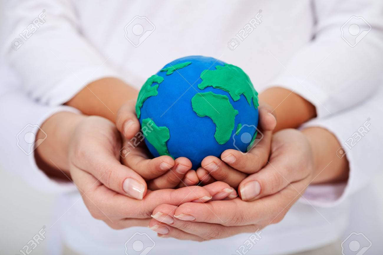 Our legacy to the next generations - a clean environment, with child and adult hands holding earth globe - 24202779