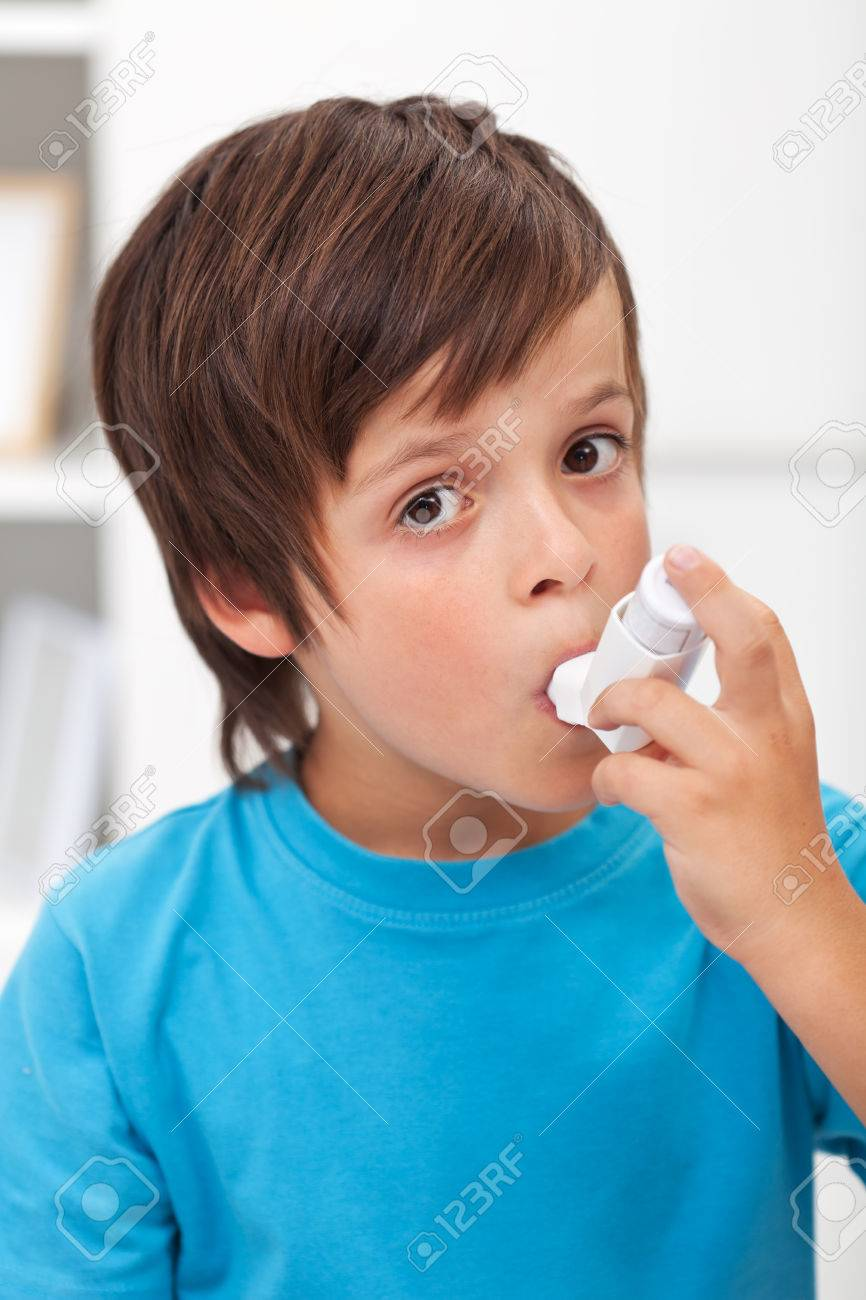 Boy using inhaler for respiratory system issues - 25210620