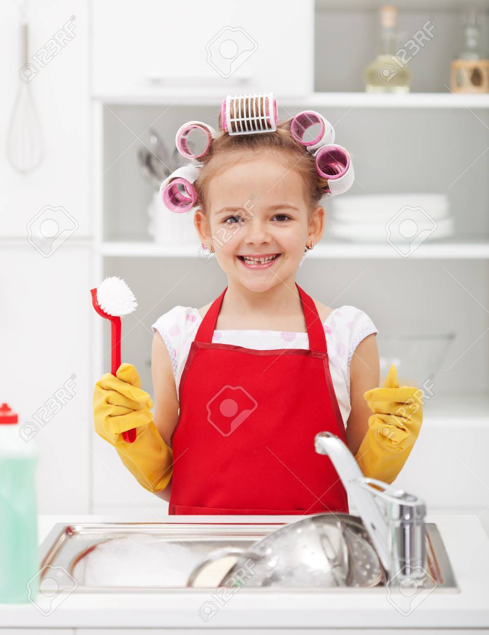 Happy housekeeping fairy - washing the dishes with a grin - 32127320