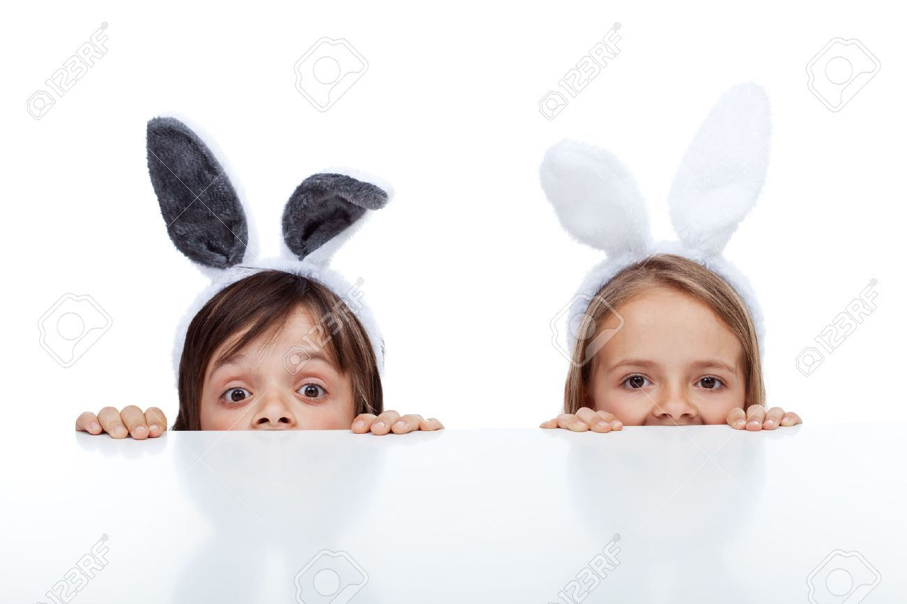 Kids with bunny ears peeking from beneath the table - waiting for the easter rabbit - 36426855