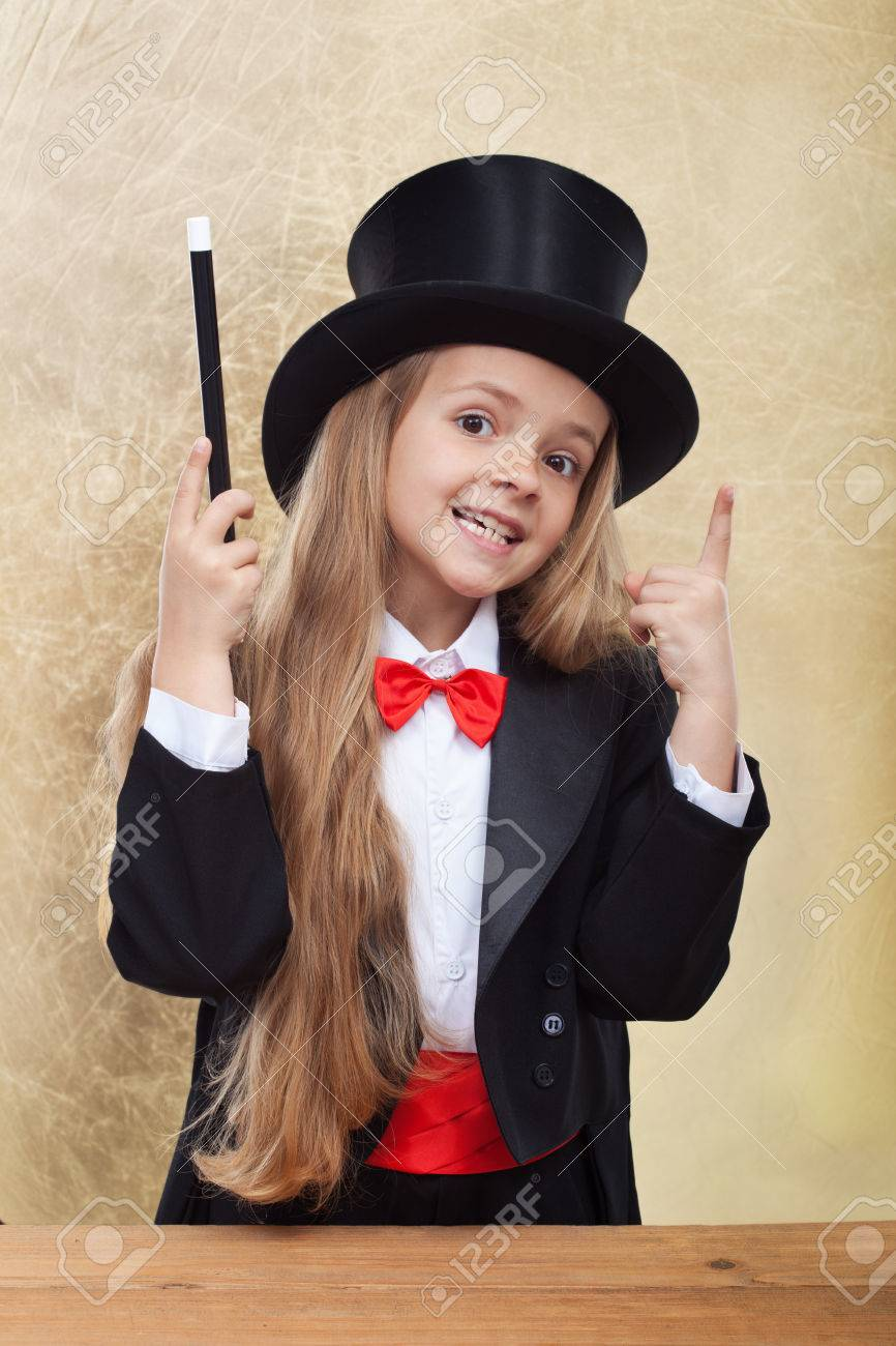 Funny magician girl with magic wand and hat - on golden background - 36426900