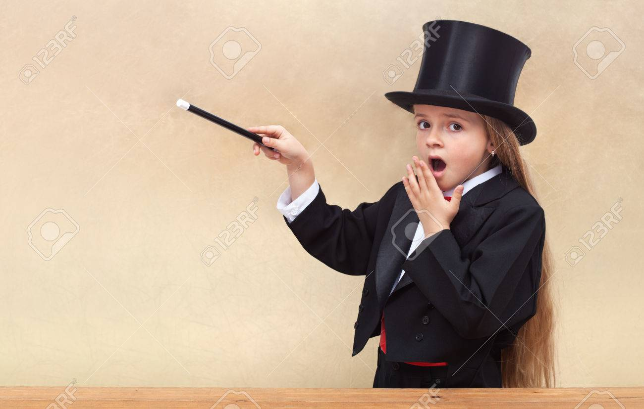 Surprised magician girl with magic wand - copy space on golden background - 36426907