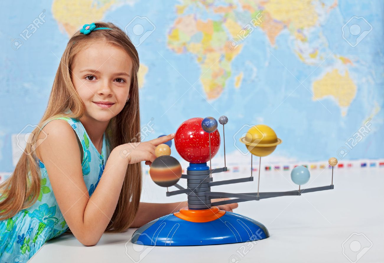 Young girl study solar system in geography science class using a scale model - 40086806