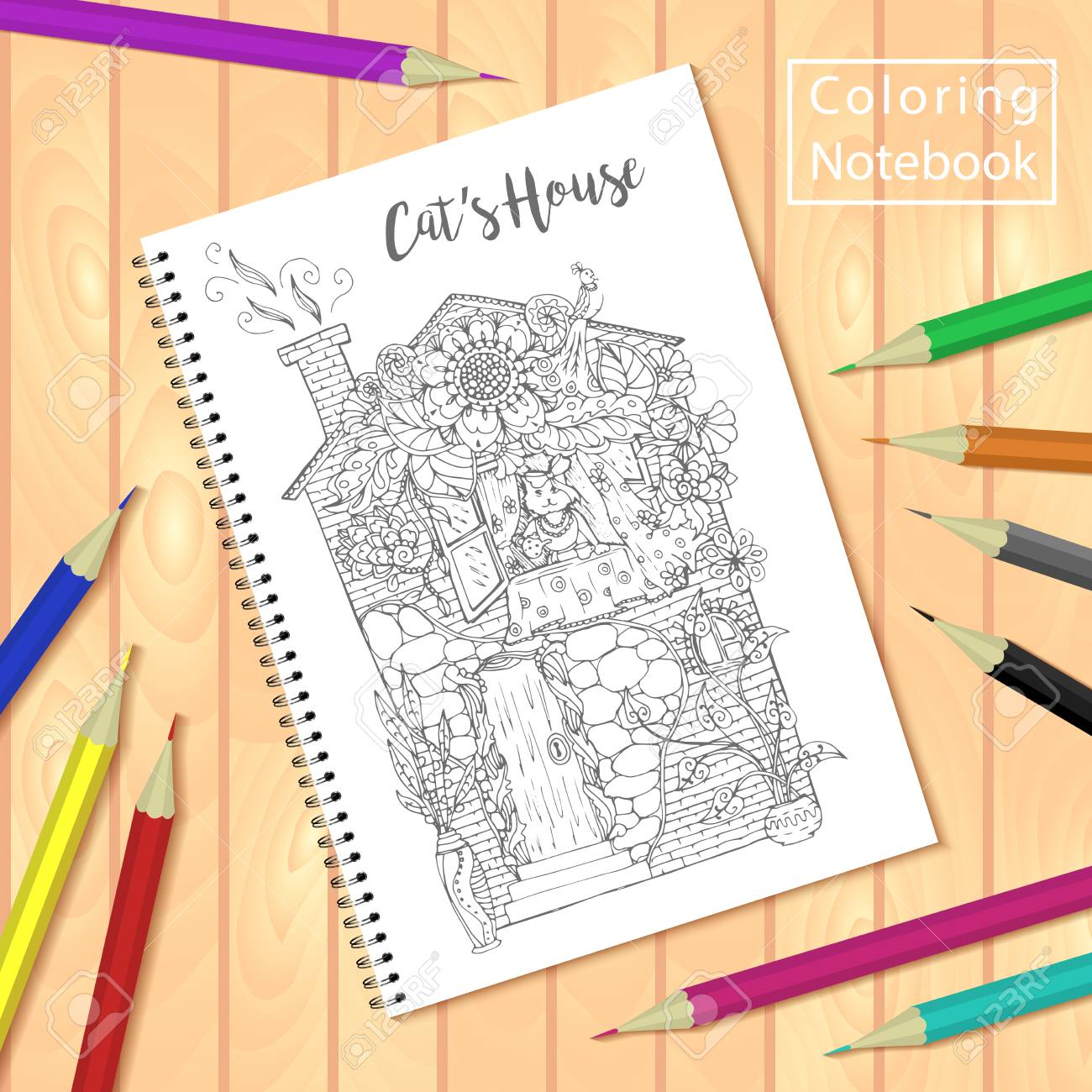 Spiral bound notepad or coloring book with colorful pencils and..