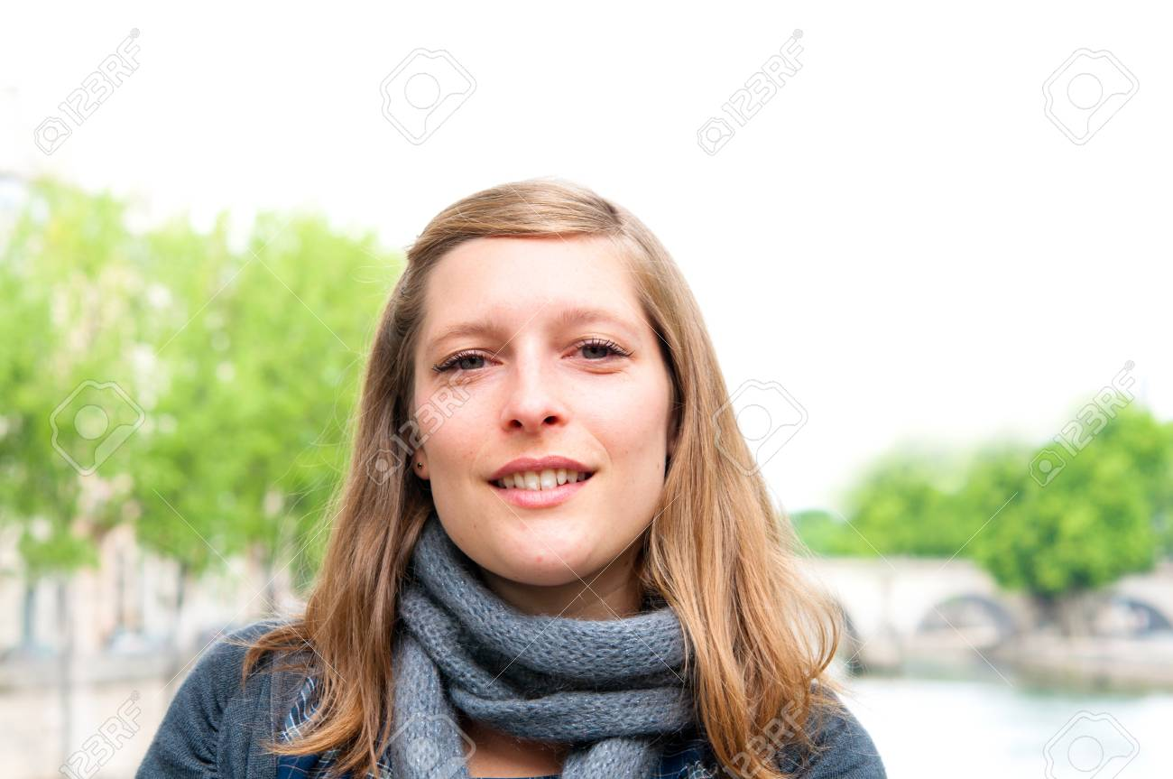 Woman smiles in the streets of Paris Stock Photo - 9796230