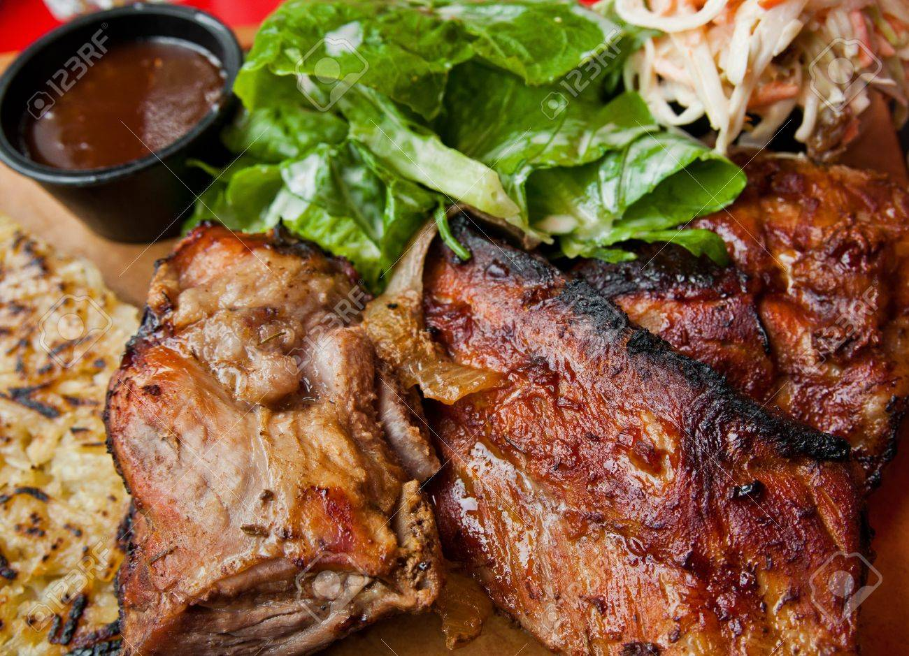 Grilled steak - Grilled meat ribs on the plate with hot sauce Stock Photo - 10790457