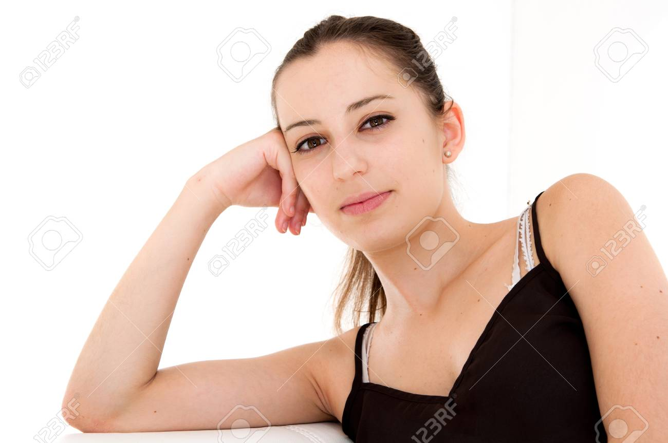 portrait of young woman holding her face on the couch in the living room Stock Photo - 12377024