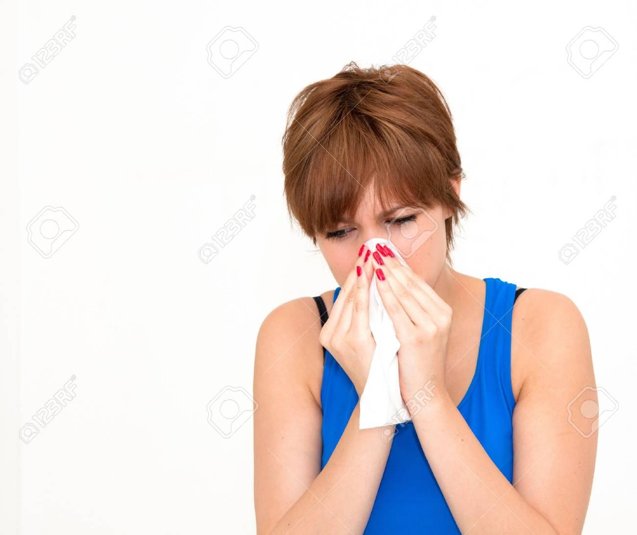 woman using tissue on white background Stock Photo - 13300397