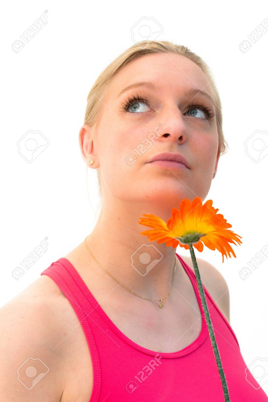 charming young woman with a flower and thinking about love Stock Photo - 13842701