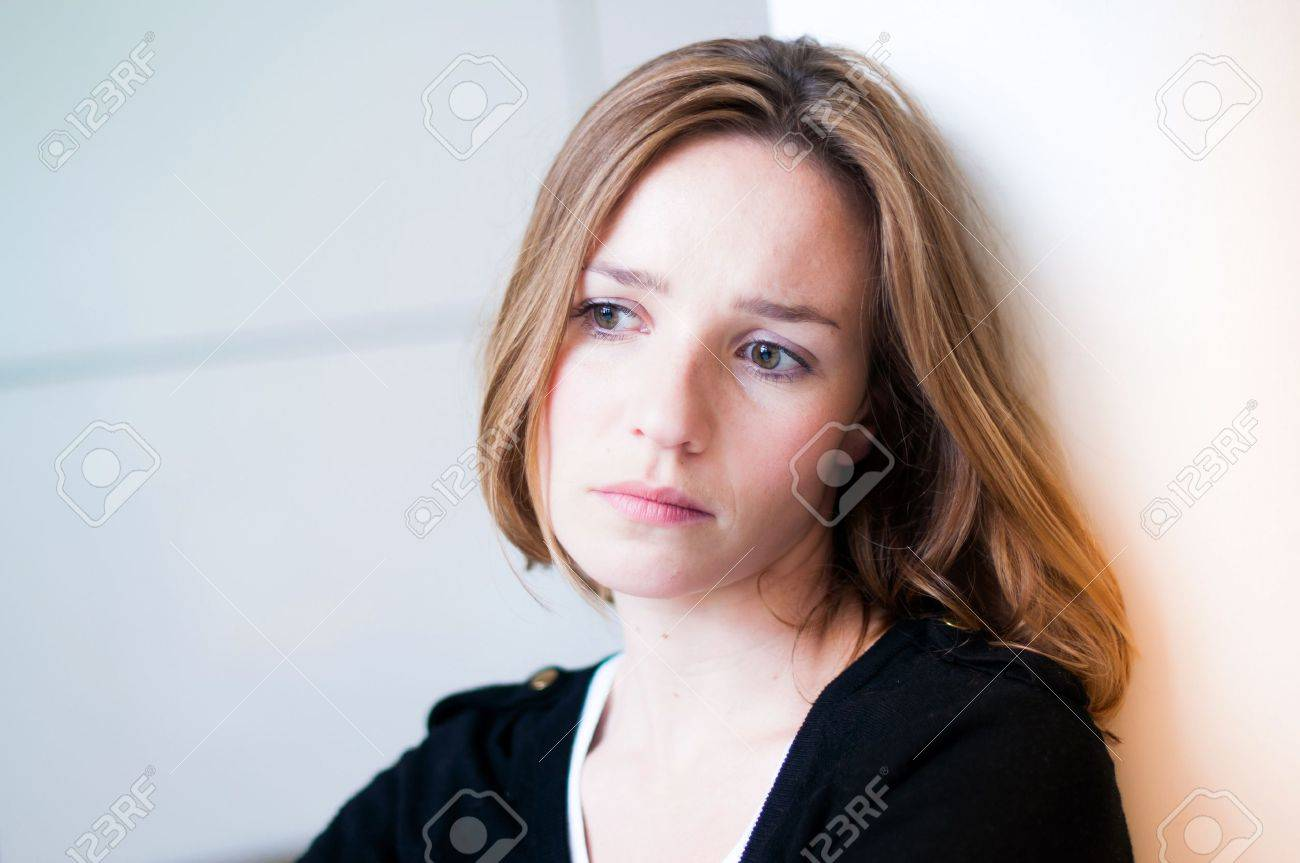 Depressed, sad woman in the living room Stock Photo - 16272444