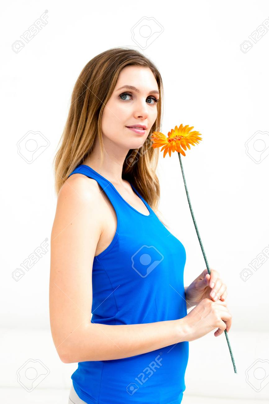 Beautiful woman with flower on white background Stock Photo - 16575352