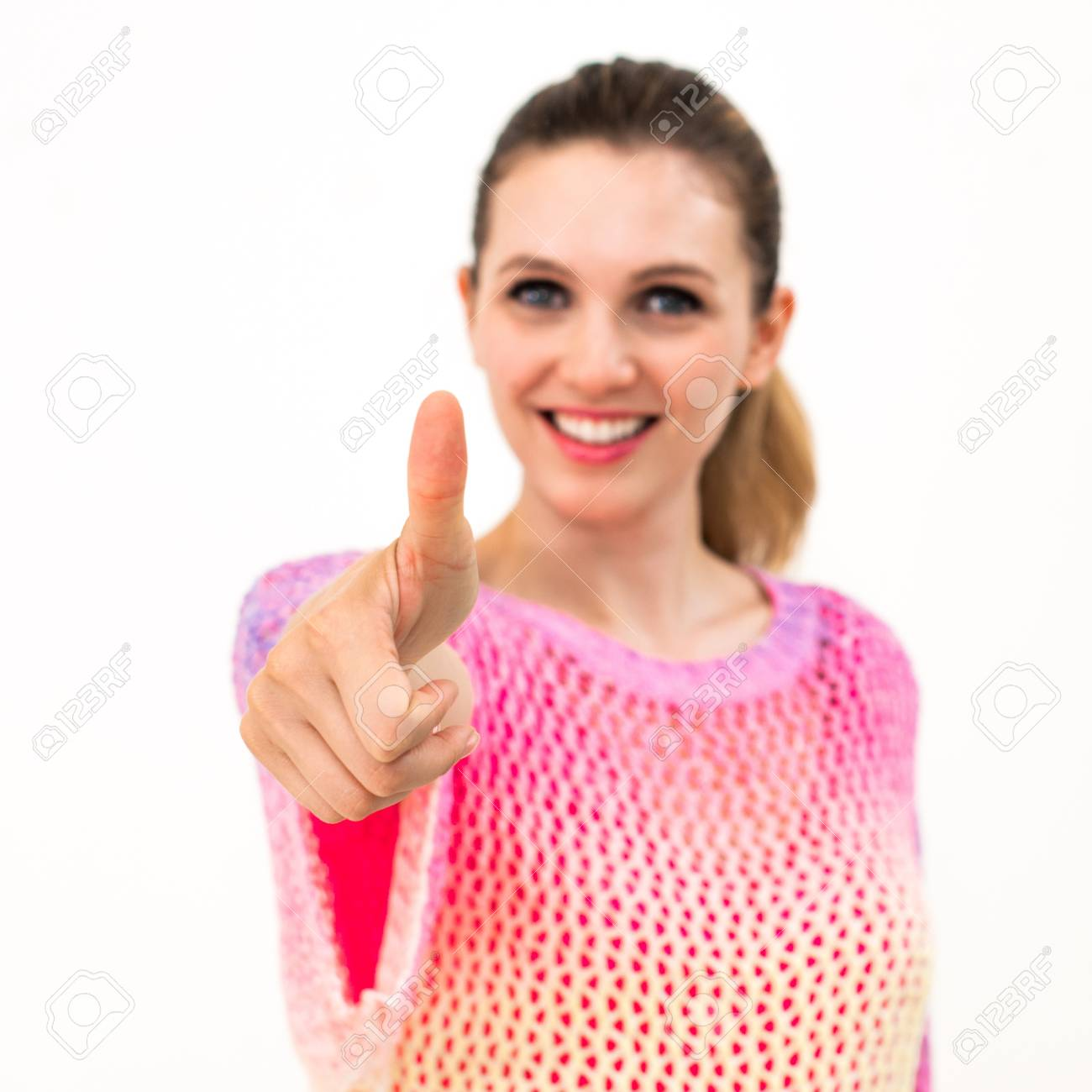 young smiling woman thumb as a sign of approval on the white background Stock Photo - 20336603
