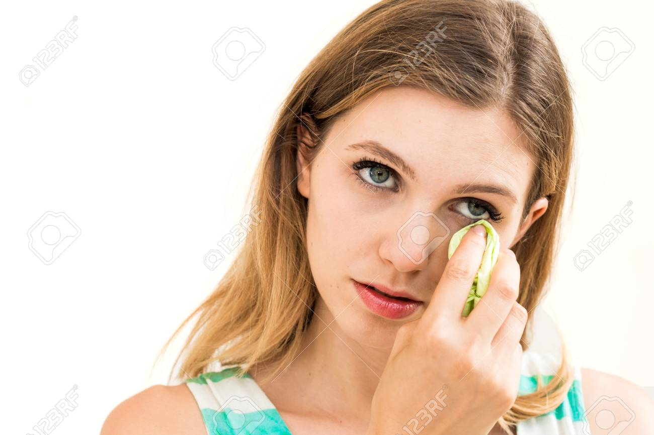 Sad woman with tissues on white background Stock Photo - 23050865