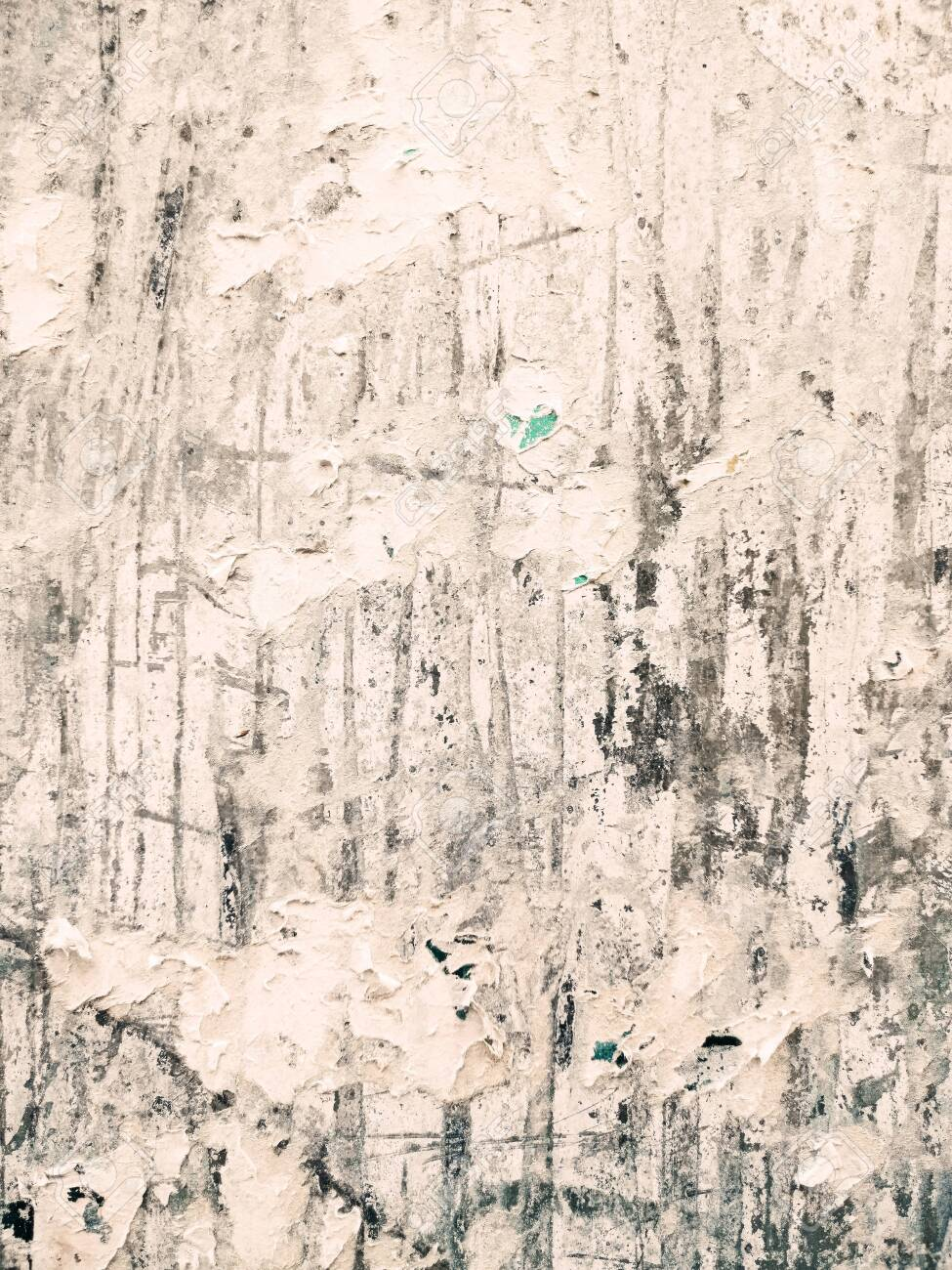 Vintage old posters sticked and torn on wall for your grunge background - 133954062