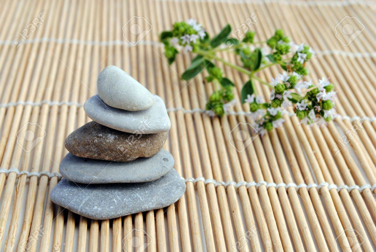 zen stones on bamboo background. concept of meditation, armony, relax and wellness Stock Photo - 10023909