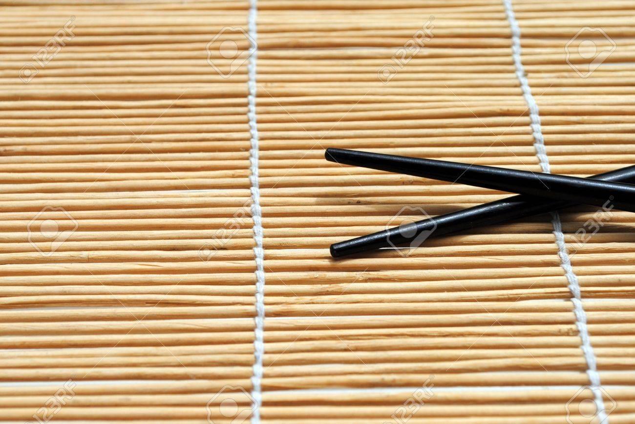 japanese chopsticks on bamboo placemat background stock photo  - japanese chopsticks on bamboo placemat background stock photo