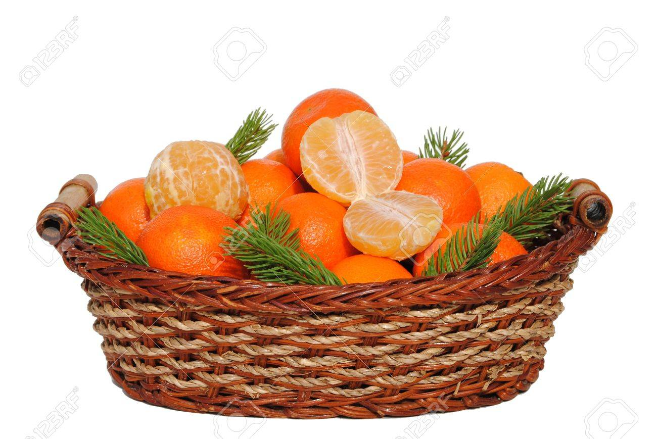 mandarin in a straw basket isolated on white background Stock Photo - 11108436