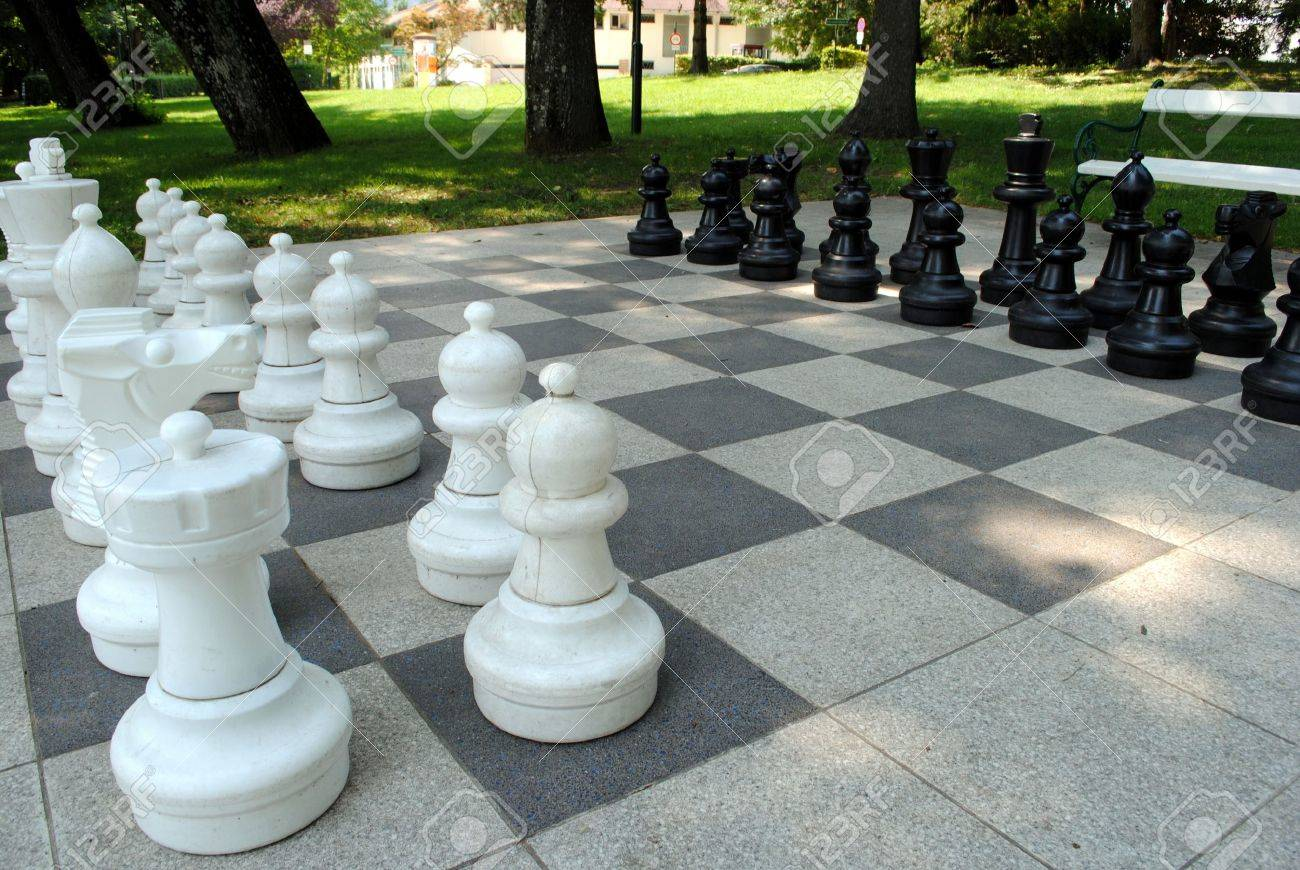 big chess set in the park with benches Stock Photo - 14962900