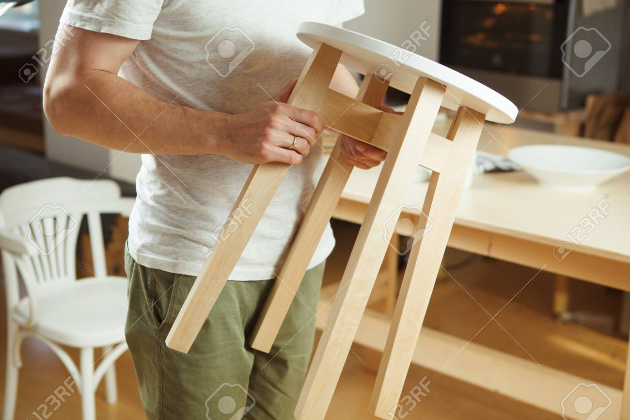 Strange Man Holding In Hands Wooden Stool Carefully Examining Seat Ocoug Best Dining Table And Chair Ideas Images Ocougorg