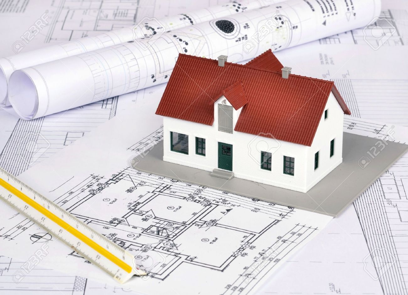 model house on a construction plan for house building stock photo model house on a construction plan for house building stock photo 20139161