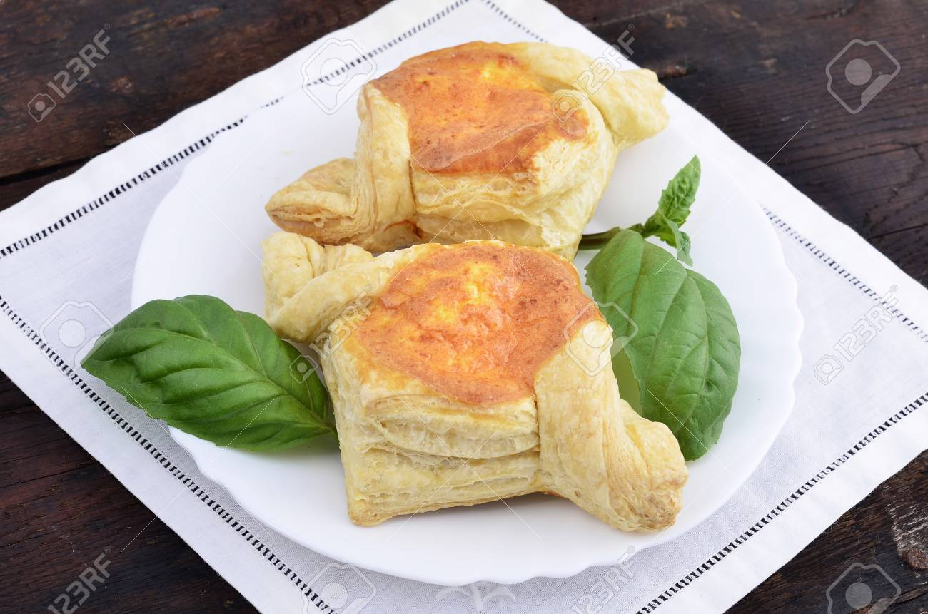 Puff pastry pies with egg and cheese a plate on wooden background green spice Stock & Puff Pastry Pies With Egg And Cheese A Plate On Wooden Background ...