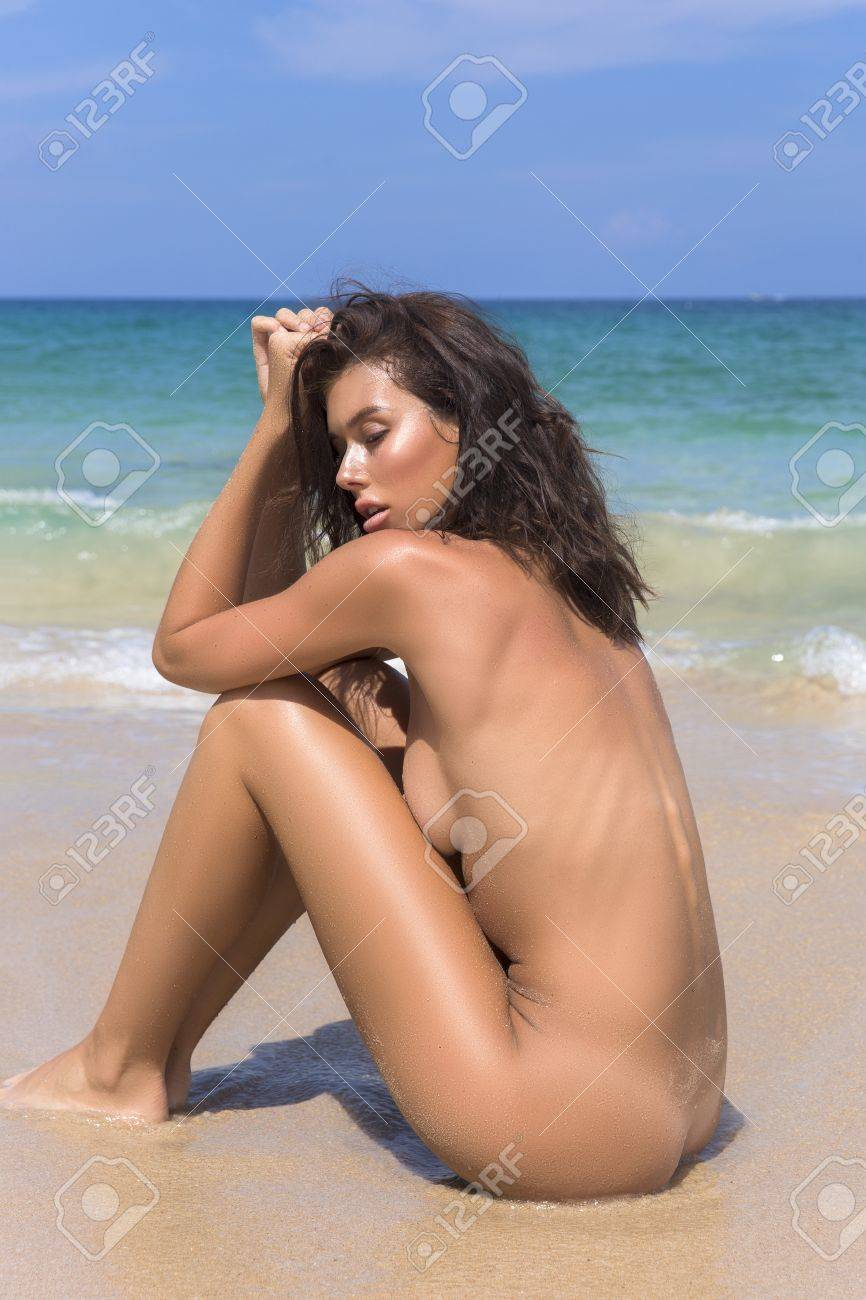 Naked Woman On Tropical Beach With Back To Camera Stock Photo