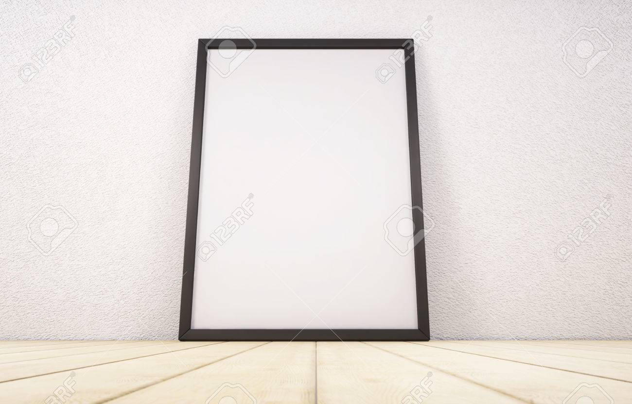 Blank White Paper Poster In Black Frame Standing On Wooden Floor