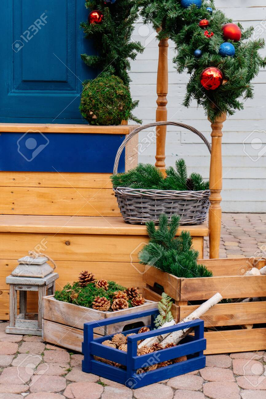 Christmas Decor Of The Front Door Wooden Boxes Wicker Basket Stock Photo Picture And Royalty Free Image Image 152428025